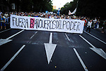 "Protestors hold a banner reading ""Bankers out of Power"" as they march in Madrid on September, 2012. Hundreds of Spaniards marched in Madrid on Saturday to protest over hardships in a recession brought on by the financial crisis that they blame on banks and corrupt politicians. ©  Pedro ARMESTRE"