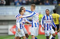 VOETBAL: HEERENVEEN: Abe Lenstra Stadion, 21-10-2012, SC Heerenveen - FC Groningen, Einduitslag 3-0, Rajiv van La Parra (#7 | SCH) wordt na zijn 3-0 gefeliciteerd door Marco Pappa (#16 | SCH) en Jeffrey Gouweleeuw (#3 | SCH), ©foto Martin de Jong