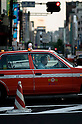 A passenger makes a phonecall as her taxi speeds through Tokyo's swanky Omotesando shopping district. And she need never run out of juice for her phone as a large number of the city's cabs now offer free phone re-charging for passengers.