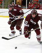 Nick Prockow (Colgate - 21), Chris Wagner (Colgate - 23) - The Harvard University Crimson defeated the visiting Colgate University Raiders 6-2 (2 EN) on Friday, January 28, 2011, at Bright Hockey Center in Cambridge, Massachusetts.
