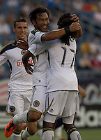 Philadelphia Union forward Carlos Ruiz (20) celebrates his goal with teammates. In a Major League Soccer (MLS) match, the Philadelphia Union defeated the New England Revolution, 3-0, at Gillette Stadium on July 17, 2011.