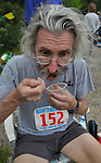Bill Wendell, from Severn MD, refuels at the 211E aid station at mile 58.2 during the  Massanutten Mountain Trails 100 Mile run (MMT 100) May 17, 2008..The aid stations provided at the MMT 100 are considered some of the best in the sport. .The  MMT 100 is considered one of the toughest Ultra Marathons on the east coast. The  Massanutten Mountain Trails 100 Mile run (MMT 100) May 17, 2008.<br /> The  race is considered one of the toughest Ultra Marathons on the east coast.