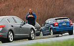 "WATERBURY, CT-042117JS03- A man holding a sign stating ""truing to survive"" looks for handouts while he stands on the median on Union Street at the entrance ram to !-84 on Friday. Waterbury Mayor Neil M. O'Leary has released his proposed panhandling ordinance which mirrors those used in other Connecticut municipalities. Jim Shannon Republican-American"