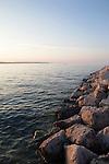 A jetty on Lake Michigan at sunset, seen from Open Space Park, Traverse City, Michigan, MI, USA