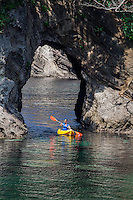 Kayaker, sea cave, Futo Beach, Izu Peninsula, Japan
