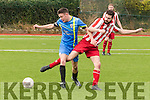 Cross Leg<br /> --------------<br /> Chris Egan, Mastergeeha tangles with Strand Rd, Tralee player Dan Kinsella in front of the ref when the sides met at Mounthawk Park, Tralee in the Greyhound cup tie.