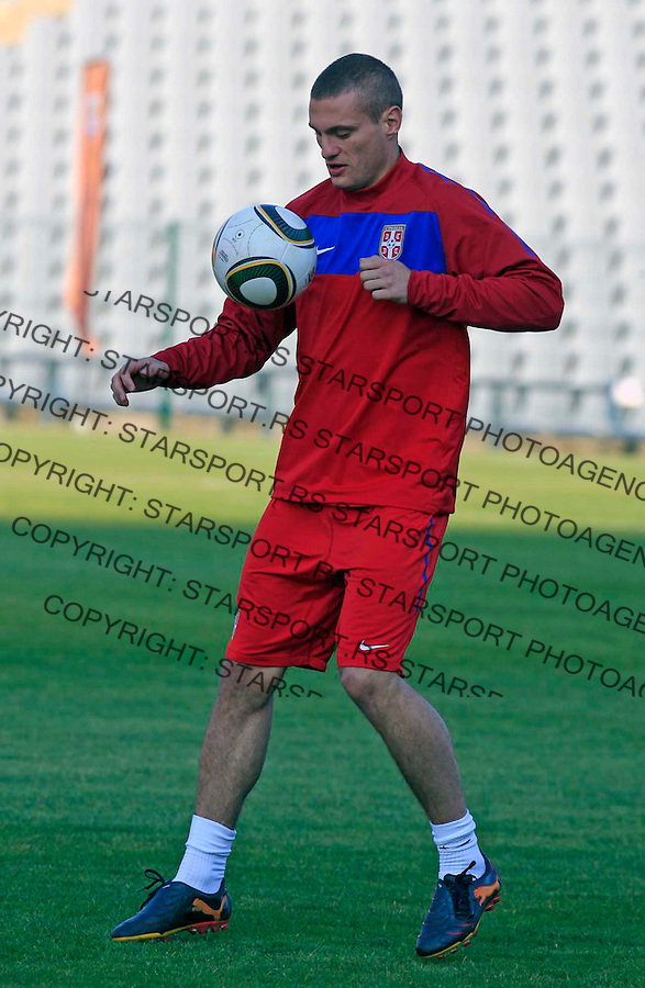 Serbia's soccer team player Nemanja Vidic  controls the ball during a team training session at a Rand Stadium in Johannesburg, South Africa, Thursday, June 10, 2010. Serbia are preparing for the upcoming soccer World Cup, where they will play in Group D 10.6.2010 (credit & photo: Pedja Milosavljevic / +381 64 1260 959 / thepedja@gmail.com )