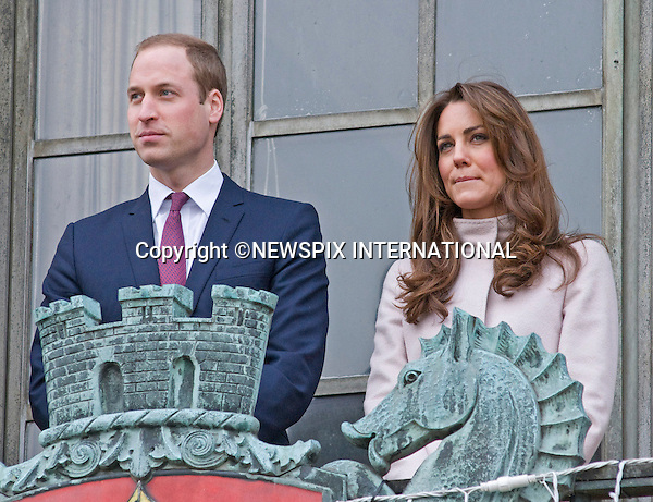 """CATHERINE, DUCHESS OF CAMBRIDGE PREGNANT .With the official confirmation by Buckingham Palace of Kate's pregnancy, careful oberservance of her mood swings can be seem from these photographs on a number of recent engagements...PRINCE WILLIAM AND CATHERINE, DUCHESS OF CAMBRIDGE - MOODS.The Royal Couple were making their first official joint visit to Cambridgeshire as The Duke and Duchess of Cambridge. _28th November 2012.The Royal couple visited The Guidhall, Senate House at the University of Cambridge, Jimmy's and The Manor School..On the day of his wedding, The Queen conferred the Dukedom of Cambridge on Prince William. The Prince then became His Royal Highness The Duke of Cambridge and his wife, Miss Catherine Middleton, became Her Royal Highness The Duchess of Cambridge on marriage. .Mandatory credit photo:©NEWSPIX INTERNATIONAL..(Failure to credit will incur a surcharge of 100% of reproduction fees)..**ALL FEES PAYABLE TO: """"NEWSPIX  INTERNATIONAL""""**..Newspix International, 31 Chinnery Hill, Bishop's Stortford, ENGLAND CM23 3PS.Tel:+441279 324672.Fax: +441279656877.Mobile:  07775681153.e-mail: info@newspixinternational.co.uk"""