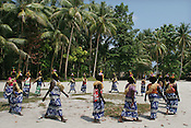 """Welcome ceremony"" on Han Island, Carteret Atoll, Papua New Guinea, on Sunday, Dec. 10, 2006.  Rising sea levels have eroded much of the coastlines of the low lying Carteret islands (situated 80km from Bougainville island, in the South Pacific), and waves have crashed over the islands flooding and destroying what little crop gardens the islanders have. Food is in short supply, banana and swamp taro crops are failing due to the salt contamination of the land, and the islanders live on a meagre one meal per day diet of fish and coconut. There is talk by the Autonomous Region of Bougainville government to relocate the Carteret Islanders to Bougainville island, but this plan is stalled due to a lack of finances, resources, land and coordination."