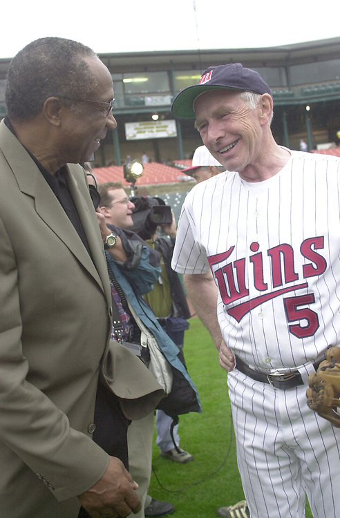 Baseball13(TW)072700- Frank Robinson chats with Democratic Coach Martin Sabo before the Hall of Famer threw out the games first pitch.