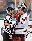 Kevin Keenan had a long conversation with Chris Rawlings (Northeastern - 37). - The visiting Rensselaer Polytechnic Institute Engineers tied their host, the Northeastern University Huskies, 2-2 (OT) on Friday, October 15, 2010, at Matthews Arena in Boston, MA.