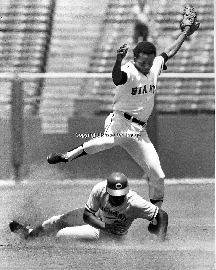 San Francisco Giants 2nd baseman Tito Fuentes leaps over Reds catcher Hal King after completing double play in the 5th inning of the Giants Cincinnati Reds.<br />