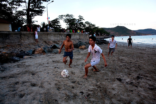 Local Vietnamese play soccer on the beach next to Pier 914 on Con Son Island, part of Con Dao Islands in Vietnam. The pier is named after the number of prisoners who were killed during the construction process. Photo taken Thursday, May 5, 2010...Kevin German / LUCEO For the New York Times