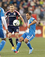 Philadelphia Union midfielder Danny Cruz (44) clears the ball. In a Major League Soccer (MLS) match, the New England Revolution (blue/red) defeated Philadelphia Union (blue/white), 2-0, at Gillette Stadium on April 27, 2013.