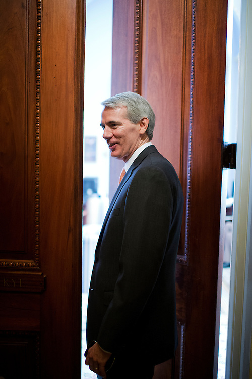 UNITED STATES - JULY 31:   Sen. Rob Portman, R-Ohio, talks with a reporter outside of the office of Senate Minority Whip Jon Kyl, R-Ariz., before senate luncheons in the Capitol.  (Photo By Tom Williams/CQ Roll Call)