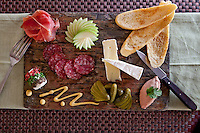 French Paradox:   duck liver mousse p&acirc;te, prosciutto, dry-cured salami, fine cheeses, cornichons, house-made dijon mustanrd, crostinis<br />