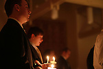 A member of the Delta Sigma Phi stands at the Candlelight Vigil for Alex Ehr in the Newman Center in Lexington, Ky., on 2/23/12. Photo by Brandon Goodwin | Staff