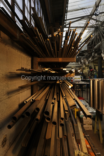 Lengths of steel stored on shelves in the Soleil Rouge workshop of Nicolas Desbons, metalworker and artist, photographed in 2017, in Montreuil, a suburb of Paris, France. Desbons works mainly in steel but often in conjunction with other materials such as fibreglass, glass and clay, using both cold metal and forge techniques. He produces both figurative and abstract sculptures as well as furniture and lighting. Picture by Manuel Cohen