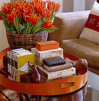 Detail of a vase of tulips on a tray on the coffee table