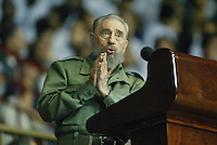 "The Cuban President Fidel Castro, attends the graduation act of more of 3000 art instructors, guarded by two personal guards, in areas of the ""Ciudad Deportiva"", Friday, October 28, 2005 in Havana, Cuba. . Credit: Jorge Rey/MediaPunch"