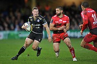 Chris Cook of Bath Rugby takes on the Toulon defence. European Rugby Champions Cup match, between Bath Rugby and RC Toulon on January 23, 2016 at the Recreation Ground in Bath, England. Photo by: Patrick Khachfe / Onside Images