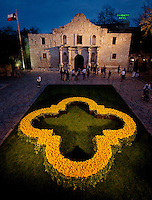 In this photograph provided by the San Antonio Convention & Visitors Bureau via AP Images, visitors tour the grounds of the Alamo around a quatrefoil made of ten thousand yellow roses, which was erected to commemorate the 175th anniversary of the Battle of the Alamo, Friday, March 4, 2011, in San Antonio. (Darren Abate/SACVB via AP Images)