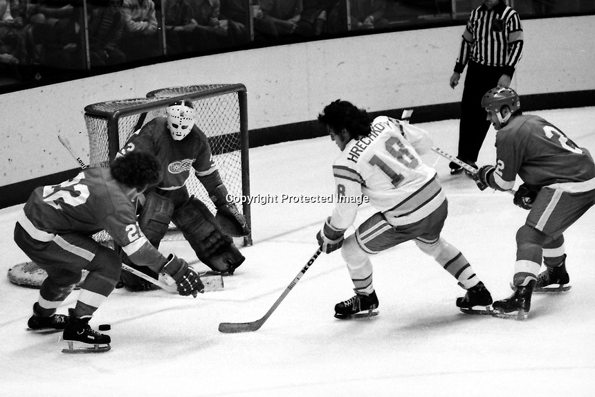 Seals Dave Hrechkosy trys to score on Detroit Red Wings goalie Terry Richardson, #22 Nelson Pyatt or Larry Giroux, #2 Gary Bergman. (1975 photo by Ron Riesterer)