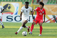 Ghana's David Addy (6) gets physical with South Korea's Jung Jin Seo (11) during the FIFA Under 20 World Cup Quarter-final match between Ghana and South Korea at the Mubarak Stadium  in Suez, Egypt, on October 09, 2009.