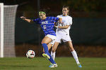 31 October 2013: Duke's Laura Weinberg (16) and North Carolina's Megan Brigman (3). The University of North Carolina Tar Heels hosted the Duke University Blue Devils at Fetzer Field in Chapel Hill, NC in a 2013 NCAA Division I Women's Soccer match. North Carolina won the game 3-0.