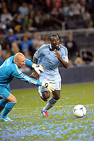 CJ Sapong, (17) Sporting KC tries to go around New England goalkeeper Matt Reis... Sporting Kansas City defeated New England Revolution 3-0 at LIVESTRONG Sporting Park, Kansas City, Kansas.
