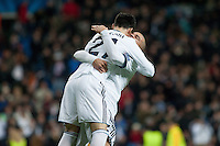 Pepe raises Callejon, giving his congratulations on the goal