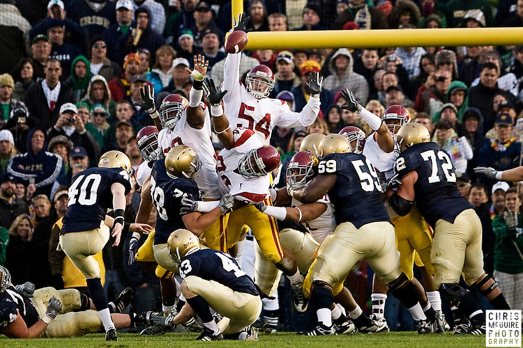 10/17/09 - South Bend, IN:  USC linebacker Chris Galippo (54) blocks a Notre Dame extra point attempt in the fourth quarter of their game at Notre Dame Stadium on Saturday.  USC won the game 34-27 to extend its win streak over Notre Dame to 8 games.  Photo by Christopher McGuire.