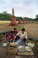 The chowkidar, or caretaker, cooks breakfast in Coronation Park on the outskirts of Delhi where the statues of rulers from the days of the British Raj now lie surrounded by desolate waste ground. They were moved from city centre locations after independence in 1947.
