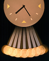 PENDULUM CLOCK -stroboscopic.Modern Wall Clock.The images of the pendulum appear farther apart at the bottom because the bob moves faster at the bottom of the swing and slows down at the top of the swing. Strobed at equal time intervals (20flashes/sec).