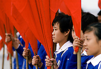 Young Chinese students with red flags at cultural display in Lintong,  China