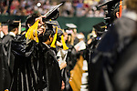A student waves to well-wishers before the start of the morning Undergraduate Commencement ceremony on Saturday, May 2, 2015.  Photo by Ohio University  /  Rob Hardin