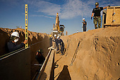 San Luis, Arizona.USA.October 23, 2006..The US National Guard constructs a new fence along the Mexican - USA border near the San Luis port of entry. Thousands of illegal immigrates cross here every year....