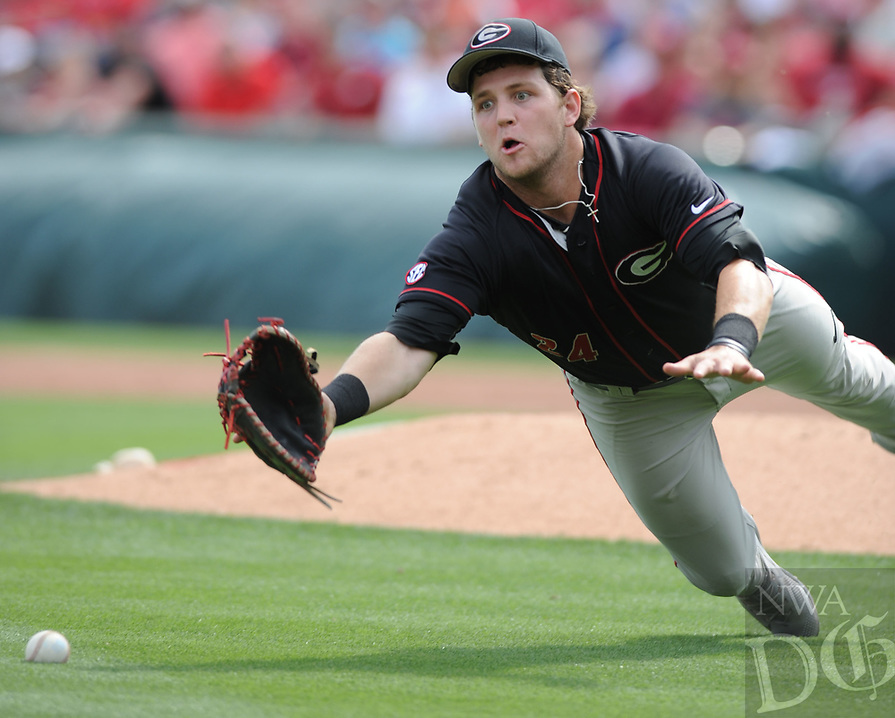 NWA Democrat-Gazette/ANDY SHUPE<br />Georgia first baseman Adam Sasser misplays a popup Saturday, April 15, 2017, against Arkansas during the fourth inning at Baum Stadium in Fayetteville. Visit nwadg.com/photos to see more photographs from the game.