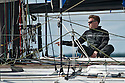 10th August 2011. Cowes. Isle of Wight..Pictures showing Ewan Mcgregor onboard Hugo Boss, skippered by British offshore racer Alex Thomson, during The Artemis Challenge round the Island race...Aberdeen Asset Management Cowes Week 2011...Credit: Lloyd Images.