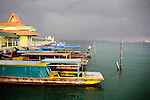 Colorful boats line the pier of Penyenget, Indonesia, on Tuesday, April 20, 2010.