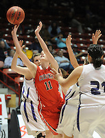 gbs030912w/SPORTS/Greg Sorber --  Corona's Shelly Gensler, 11, shoots between Elida defenders during the B Girls State Championship in the Pit on Friday, March 9, 2012. Elida beat Corona 59-41.