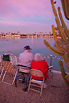 Ernie and Jeanie Thompson await the holiday boat parade at the Holiday Around the World Celebration in Sun City, Az  at the Lakeview Recreation Center December 10, 2010...2010 marks the 50th anniversary of Sun City, America's first retirement city that remains the largest today with more than 40,000 residents 55 and older.