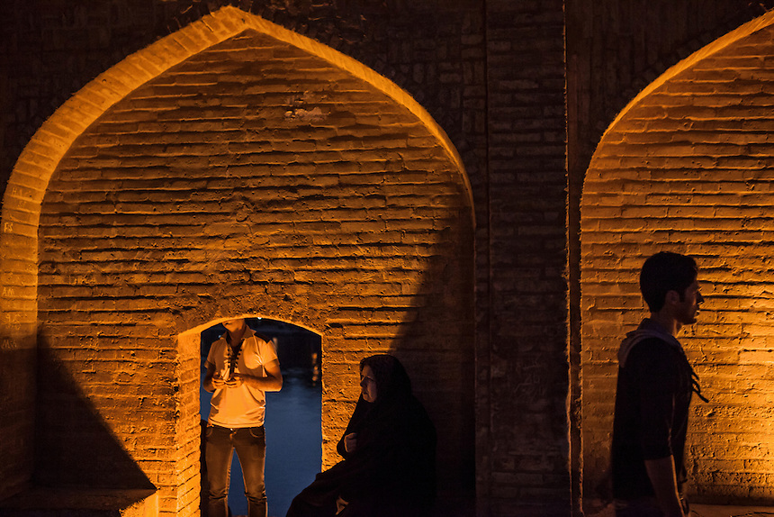 Early evening, Iranian gather at Si-o-Seh Pol. Si-o-Seh Pol, a 298m long bridge with 33 arches, was built by Allahverdi Khan between 1599 to 1602 to link the two halves of Chahar Bagh street. It is also served as a dam, and still in use today to hold the water.