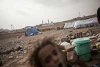 Thursday 16 July, 2015: A displaced child from the heavy fighting and bombarments in Sa'dah governorate and Haradh bordertown is seen in a temporary settlement in the outskirts of Khamer city in the Amran province of Yemen. (Photo/Narciso Contreras)