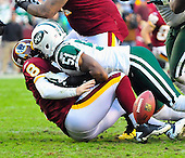 New York Jets linebacker Aaron Maybin (51) forces Washington Redskins quarterback Rex Grossman (8) to fumble in the fourth quarter at FedEx Field in Landover, Maryland on Sunday, December 4, 2011.  The Jets won the game 34 - 19..Credit: Ron Sachs / CNP.(RESTRICTION: NO New York or New Jersey Newspapers or newspapers within a 75 mile radius of New York City)