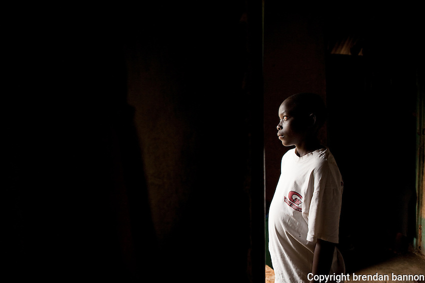 MSF patient Clinton at home in his grandparents house. Clinton has  been recieving medical care for HIV  since 2003. He has yet to begin  ARVs.  His parents died within six months of each other from AIDS. They refused to be tested and never sought treatment.