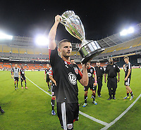 Perry Kitchen (23) of D.C. United presenting the U.S. Open Cup Trophy to the fans at  the end of the game.  The Chicago Fire defeated D.C. Untied 3-0, at RFK Stadium, Friday October 4 , 2013.