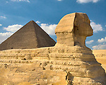 "Giza, Cairo, Egypt -- Viewed from the side, the Great Sphinx, part of the funerary temple of Khafre (Kephren), sits in the foreground with the ""Great Pyramid"" of Khufu (Cheops) in the background. © Rick Collier / RickCollier.com."