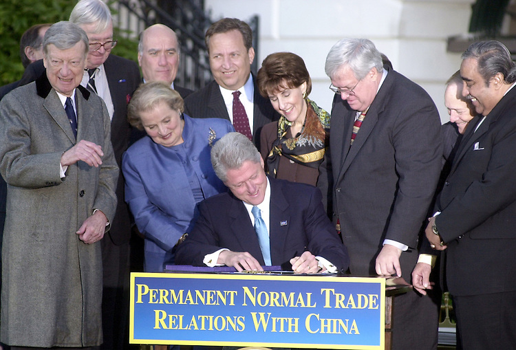 PNTR2101100 -- President Clinton flanked by Sen. William V. Roth, R-Del., left, and House speaker J. Dennis Hastert, R- Ill., signed a bill permanently normalizing trade relations with China on the south lawn of the White House.