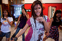 The 'Me N Ma Girls', Myanmar's first girl band, rehearse their act. The band's members were recruited by Australian dancer Nicole May. They sing and dance in the manner of many Western pop acts but in socially conservative Myanmar, they represent a radical break from the norm.